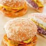 homemade McDonald's quarter pounder burgers on parchment paper.