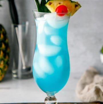 a homemade Olive Garden Blue Hawaiian cocktail in a hurricane glass