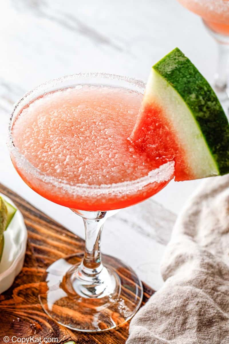 homemade Olive Garden watermelon cocktail garnished with a watermelon slice