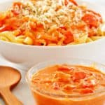 a bowl of vodka sauce in front of a bowl of penne alla vodka.