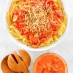 overhead view of penne alla vodka and vodka sauce in bowls.