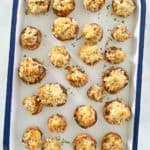 overhead view of sausage stuffed mushrooms on a serving tray.