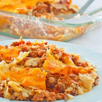 taco casserole on a plate and in a baking dish