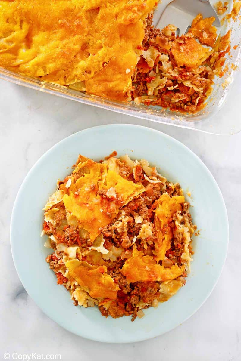 taco casserole in a baking dish and on a plate