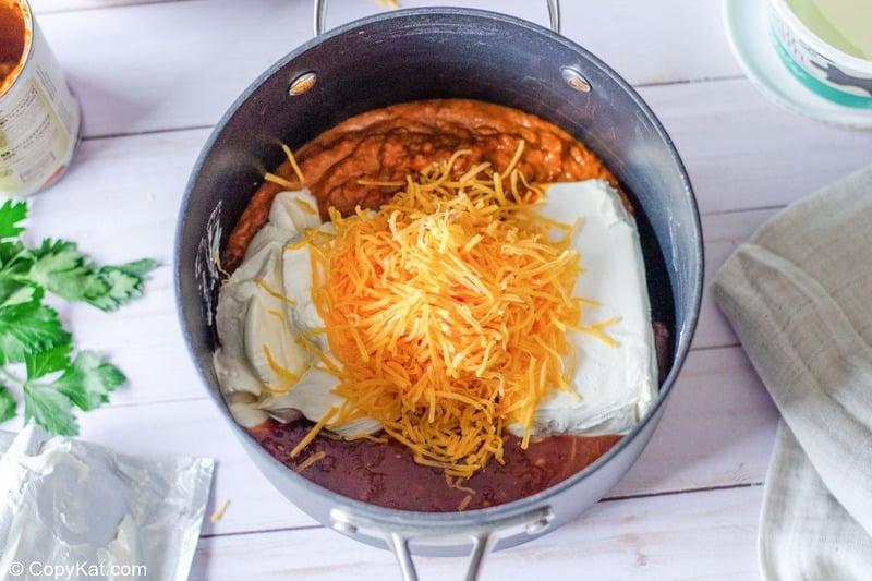 taco dip ingredients in a saucepan.