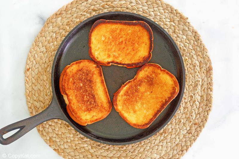 butter toasted Texas toast slices in a skillet