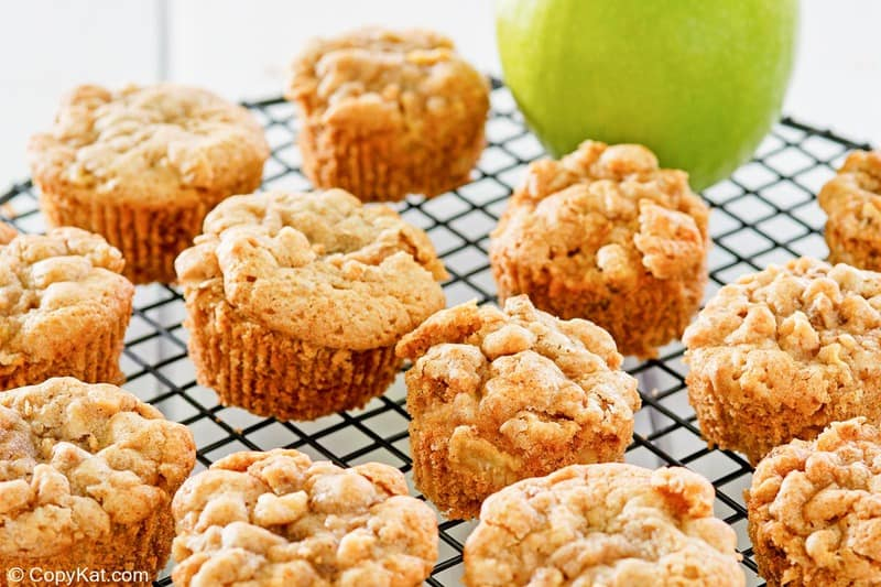 cinnamon apple muffins on a wire rack