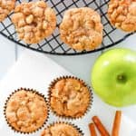 overhead view of apple muffins, cinnamon sticks, and an apple