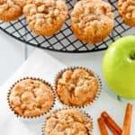 apple muffins, cinnamon sticks, and an apple
