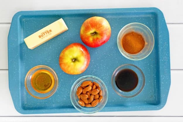 baked apples ingredients on a tray