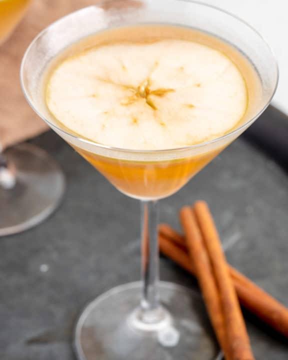 caramel apple martini garnished with an apple slice