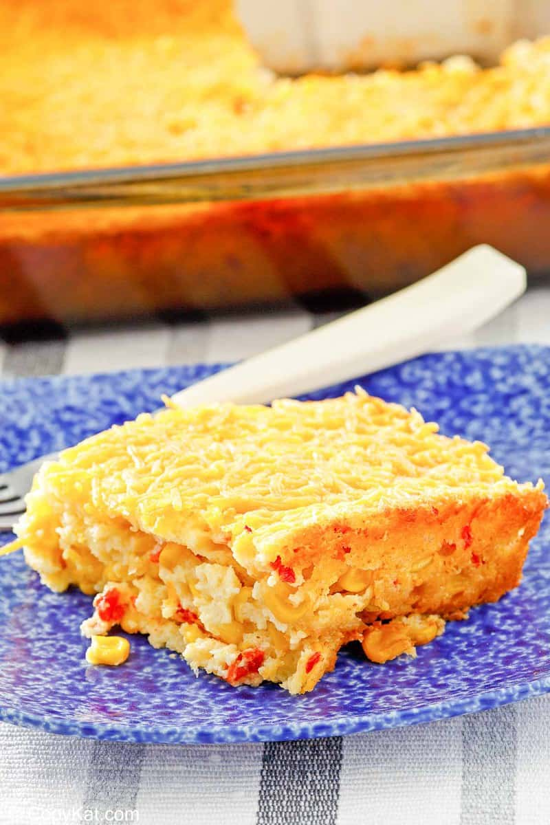 creamed corn casserole in a baking dish and on a plate