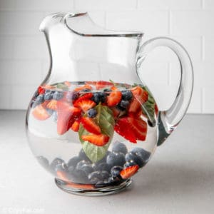fruit infused water in a pitcher.