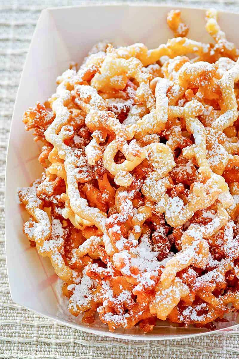 funnel cake fries in a paper serving dish