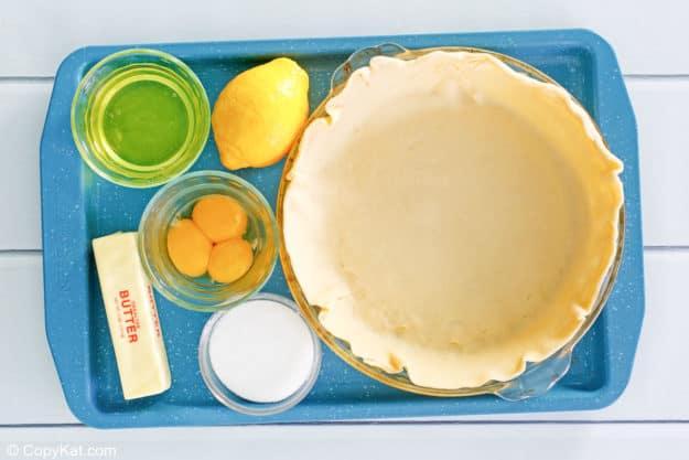 lemon meringue pie ingredients on a tray