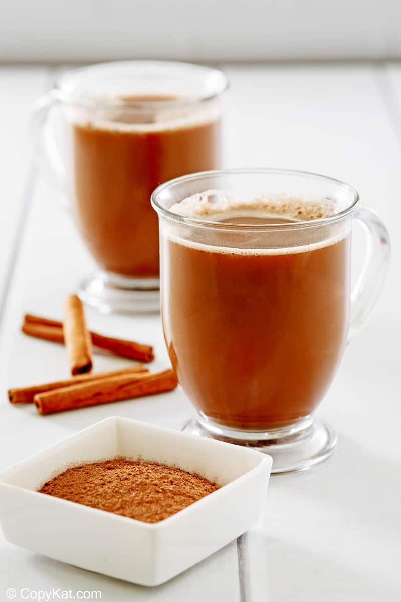 Mexican coffee in glass mugs and cinnamon sticks