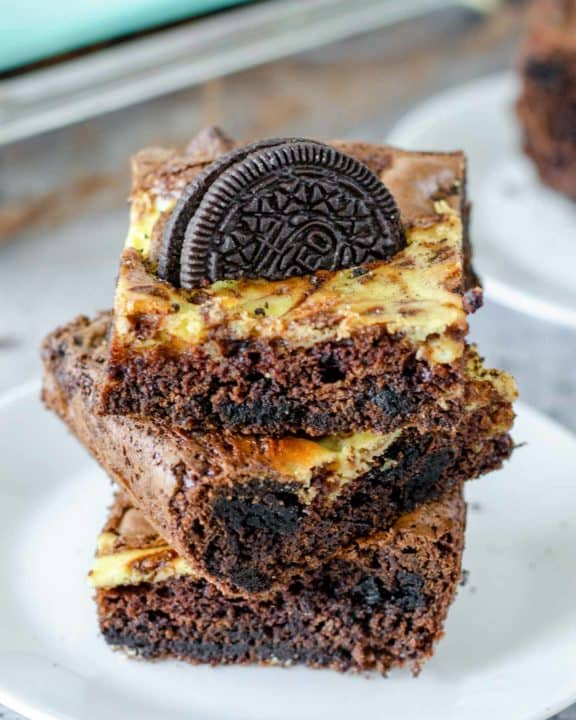 a stack of three Oreo brownies on a plate