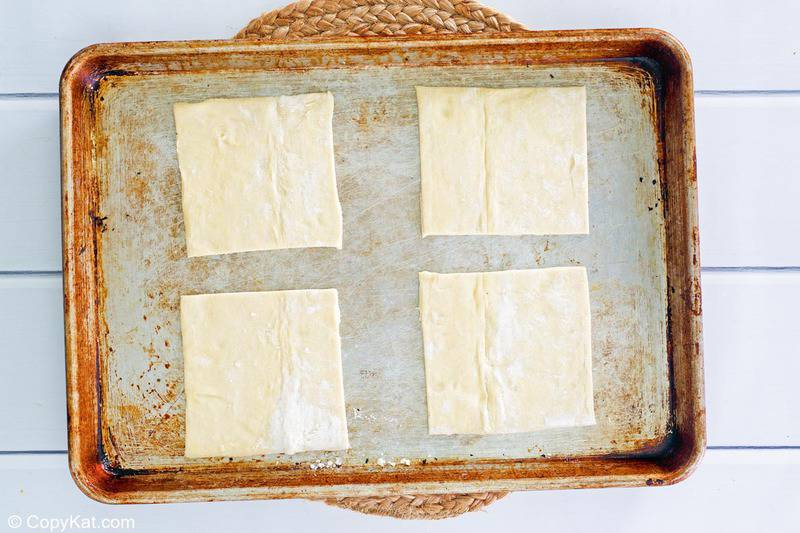 puff pastry squares on a baking sheet
