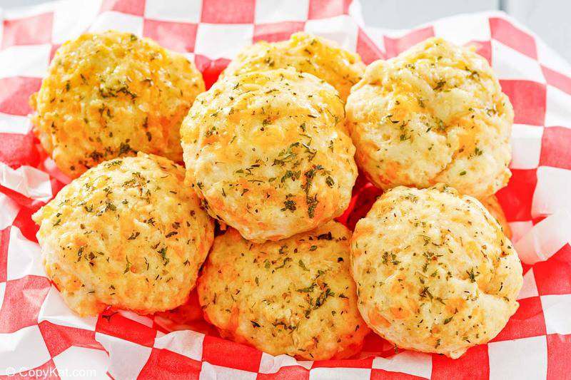 homemade Red Lobster Cheddar Bay Biscuits in a parchment paper lined bread basket