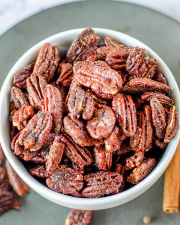 overhead view of a bowl of spiced pecans