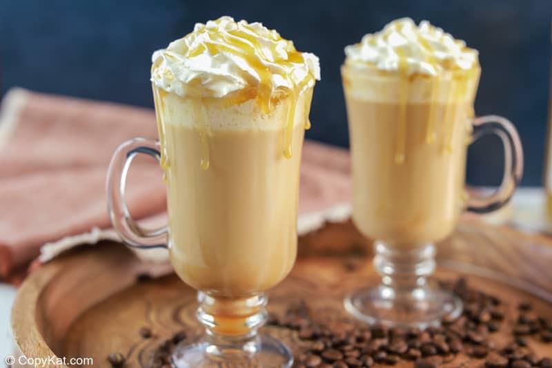 two homemade Starbucks caramel macchiato drinks on a tray