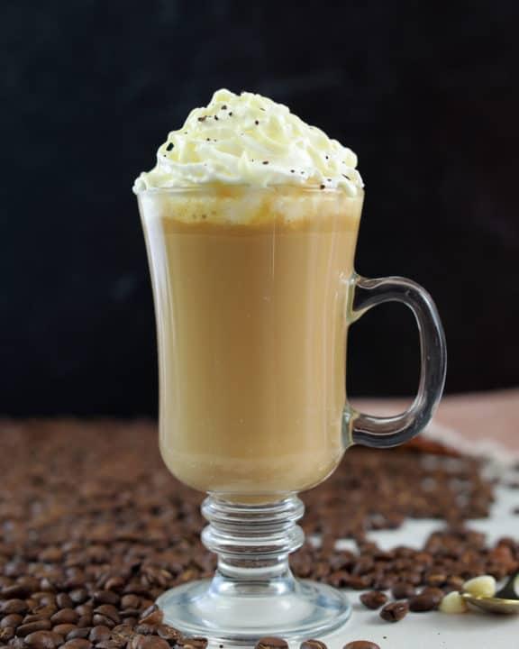 homemade Starbucks white chocolate mocha and coffee beans.