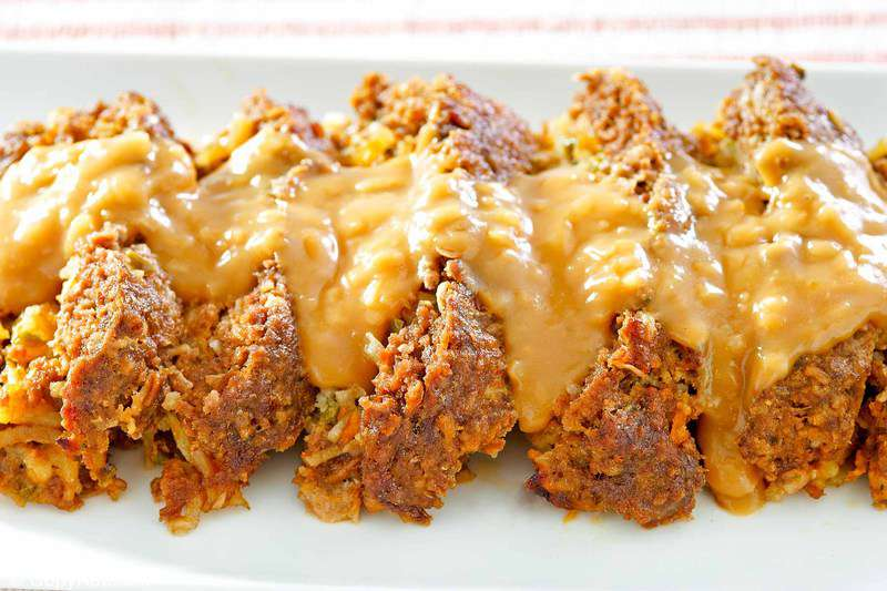 slices of stuffed meatloaf with gravy on top