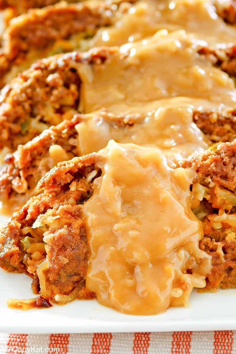 closeup of stuffed meatloaf with gravy on top