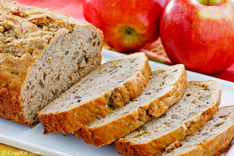 apple bread on a platter and two apples.