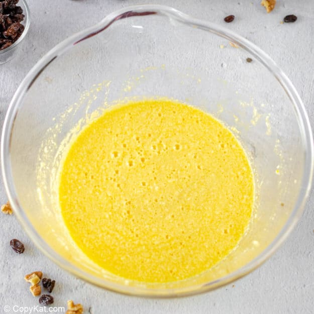 spice cake wet ingredients combined in a mixing bowl.