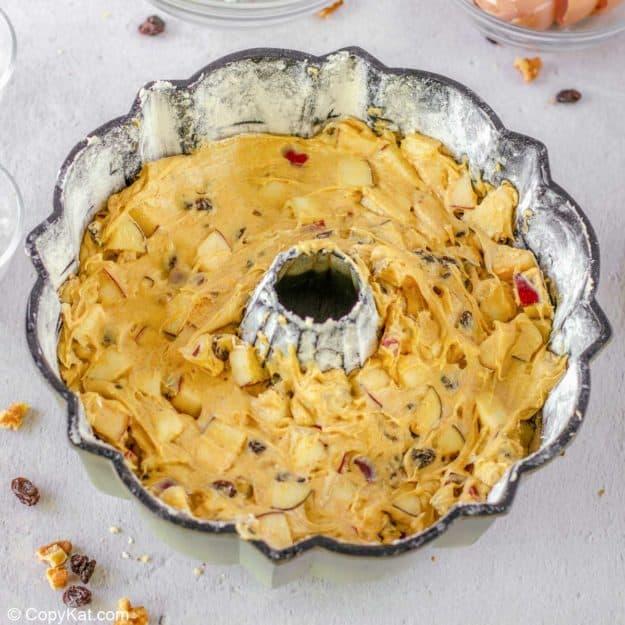 apple spice cake batter in a bundt pan.