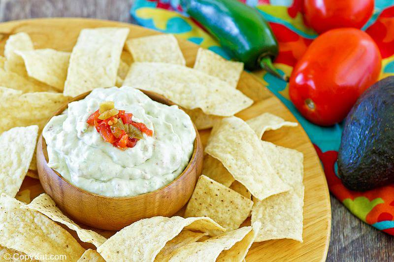 homemade Casa Ole creamy Mexican green sauce and tortilla chips on a platter.
