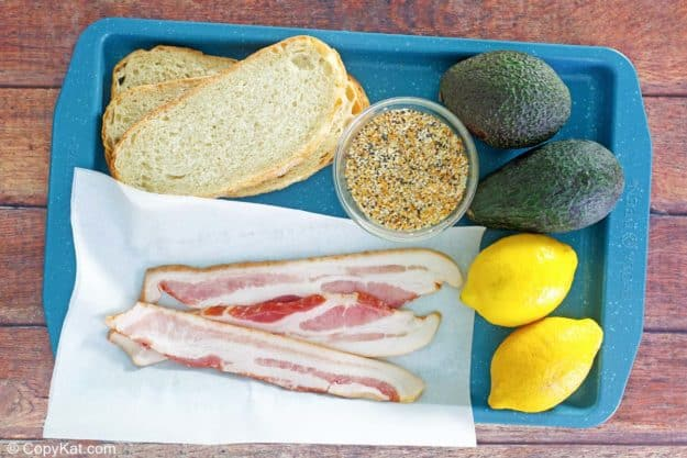 Dunkin Donuts avocado toast ingredients on a tray.