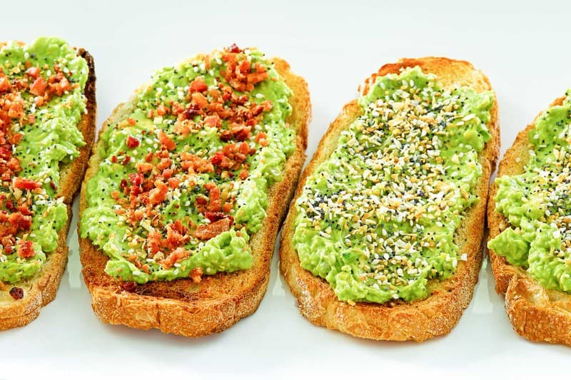 slices of homemade Dunkin Donuts avocado toast with and without bacon.