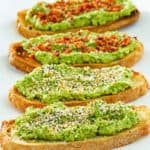 four slices of homemade Dunkin Donuts avocado toast on a platter.