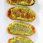 four homemade Dunkin Donuts avocado toast slices on a platter.