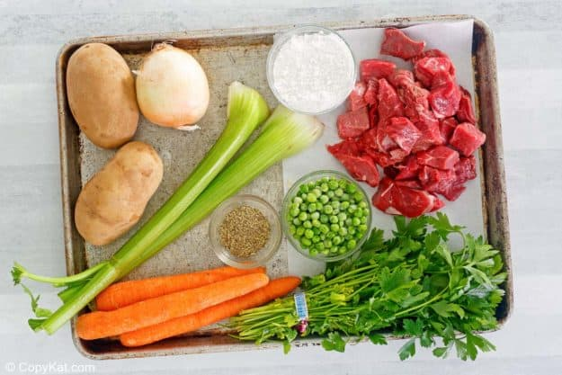 Dutch Oven beef stew ingredients on a baking sheet.