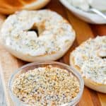 homemade bagel seasoning in a bowl, bagels, and cream cheese.