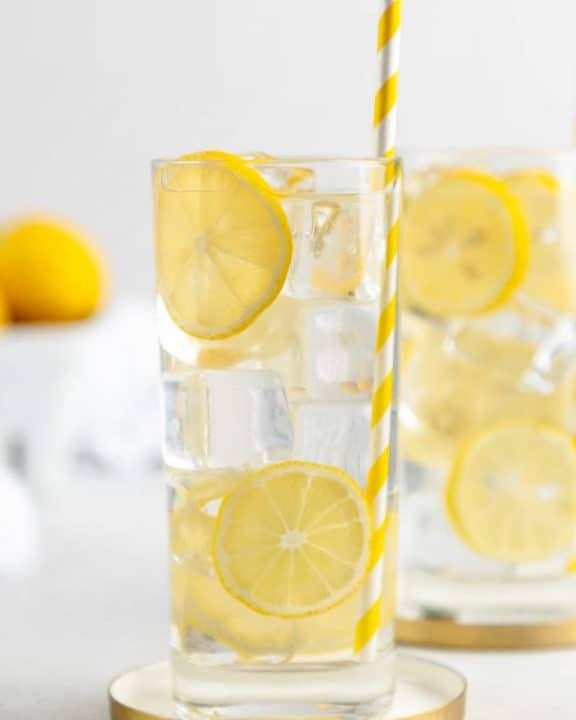 a glass of homemade lemonade garnished with lemon slices.