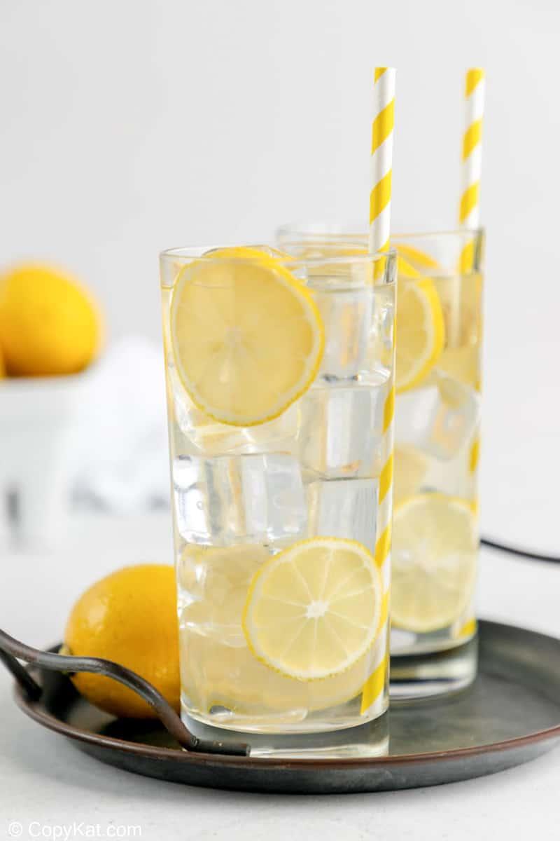 two glasses of homemade lemonade on a tray.