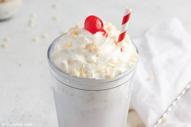 homemade Jack in the Box rice krispie milkshake with whipped cream and a cherry.