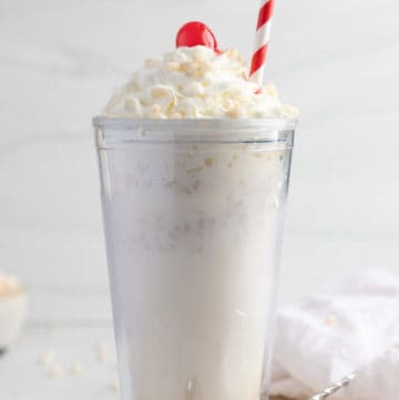 homemade Jack in the Box Rice Krispie Shake topped with whipped cream, a cherry, and cereal.