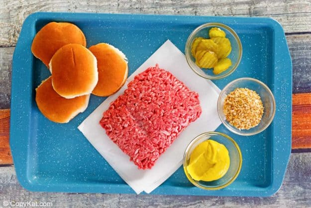 Krystal burger ingredients on a tray.