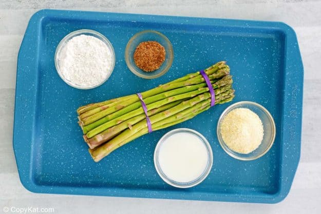 Longhorn Steakhouse parmesan crusted asparagus ingredients on a tray.