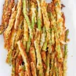 overhead view of homemade Longhorn Steakhouse parmesan crusted asparagus on a platter.