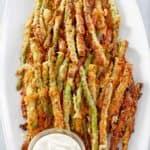 homemade Longhorn Steakhouse parmesan crusted asparagus on a platter.