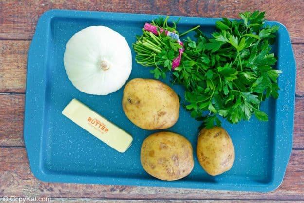 lyonnaise potatoes ingredients on a tray.
