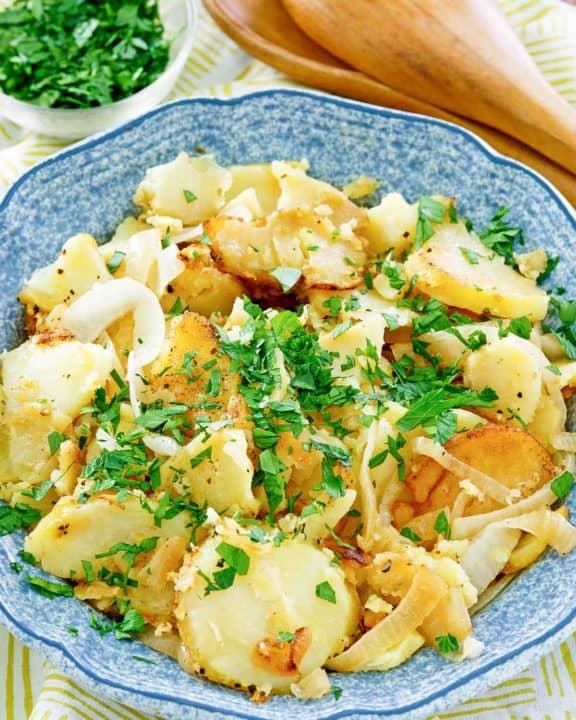lyonnaise potatoes in a blue serving bowl.