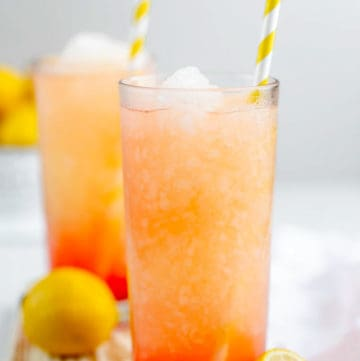 homemade McDonald's frozen strawberry lemonade in glasses with straws.