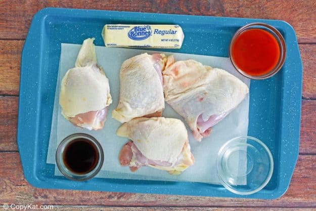 Wingstop Buffalo chicken thighs ingredients on a tray.